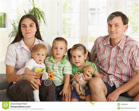 Portrait Of Nuclear Family At Home Stock Photo - Image